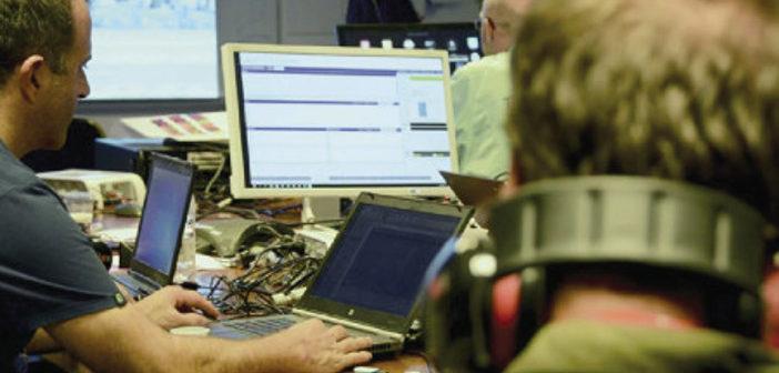 Test engineers at desks