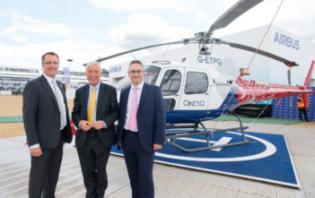 Colin James, managing director of Airbus Helicopters UK (left), Minister of State for Defence, Earl Howe (center) and Nic Anderson, QinetiQ's managing director, air & space (right)
