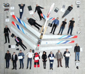 Participants in the final review of the FLEXOP project at the Technical University of Munich pose with the demonstrator