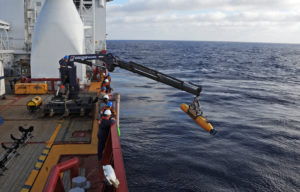 Operators aboard Australian navy vessel Ocean Shield launching an underwater vehicle to search for the missing Malaysia Airlines Flight 370