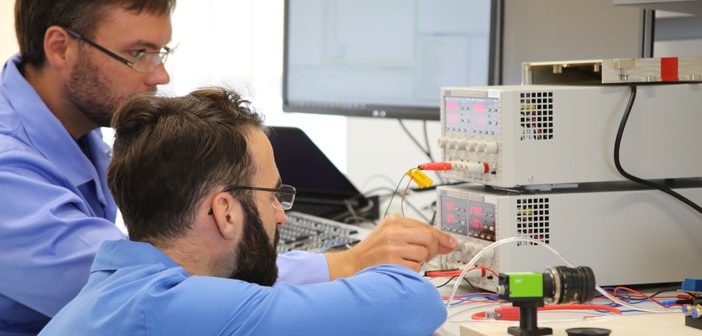 Engineers at work in the Engineering Design Centre's Avionics and Digital Systems Laboratory