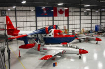 he HU-16 Albatross twin–radial engine amphibious seaplane in the hangar with the Aero L-29 Delfín military jet trainer