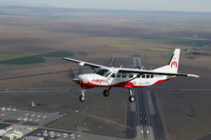 The Cessna 208B Grand Caravan retrofitted with the 750hp Magni500 propulsion system (inset) by AeroTEC during its first flight in May 2020