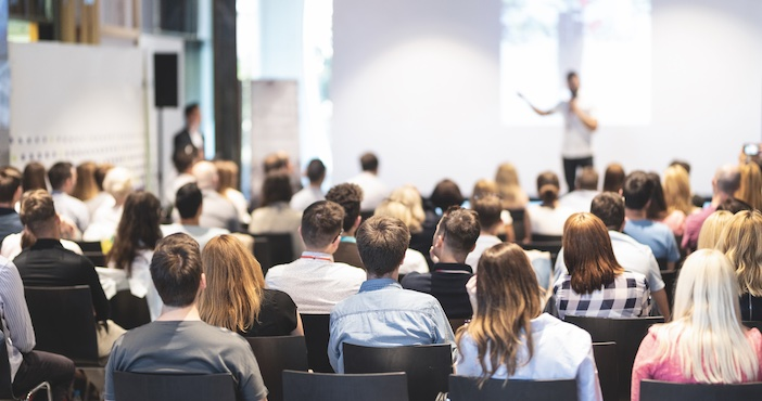 Blurred image of a crowd at a conference